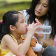 Stock Photo: Chinese asian Mother is comforting her crying daughter