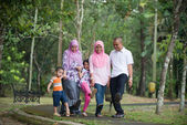 Happy indonesian Family enjoying family time playing together in — 图库照片