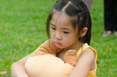 Depressed Asian chinese child. Little girl showing her unhappy f — Zdjęcie stockowe