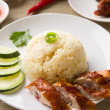 Stock Photo: Singapore roasted chicken rice with chili sauce as background