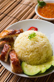 Singapore hainan chicken rice with materials as background — Stock Photo