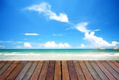 Blue beach with empty plank woods, suitable for product placemen — Stock Photo
