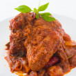 Foto Stock: Curry chicken rendang cooked in indian style with spicy sauce an