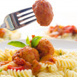Pasta with meatballs and tomato sauce on white background — Stock Photo