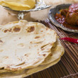 Chapatti roti, curry chicken, biryani rice, salad, masala milk t — Stock Photo #28772809