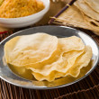 Papadum or papad with various traditional india foods — Stock Photo