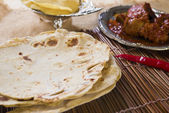 Chapatti roti, curry chicken, biryani rice, salad, masala milk t — Stock Photo