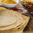 Chapatti roti, curry chicken, biryani rice, salad, masala milk t — Stock Photo #28966045