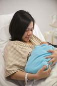 Asian mother and newborn baby girl in hospital — Stock Photo