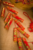Traditional chinese new year fire crackers on the red. — Stock Photo