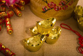 Chinese new year with decoration, large gold ingot and mandarin — Stock Photo