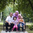 Malay family sitting and having fun in the park — 图库照片