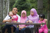 Malay muslim family having fun in the park — Stock Photo