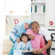 Malay family using tablet having a good time surfing internet — Stock Photo #29170227
