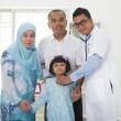 Stock Photo: Malay family visiting doctor