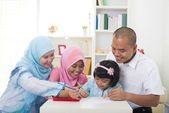 Indonesian muslim family learning together with lifestyle backg — Stock Photo