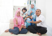 Malay family watching television enjoying quality time — Stock Photo