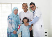 Malay family visiting the doctor — Stock Photo
