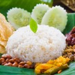 Nasi lemak, a traditional malay curry paste rice dish served on — 图库照片