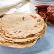 Chapatti roti and Indifood on dining table. — Stock Photo #29540799