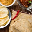 Chapathi with various indian foods in traditional lifestyle — Stock Photo #29540857