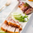 Siu Yuk,  Chinese crispy roasted belly pork with duck at the bac — Stock Photo