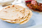 Chapatti roti and Indian food on dining table. — Stock Photo