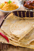 Chapathi with various indian foods in traditional lifestyle — Stock Photo