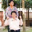 Asian senior enjoying swing in the park  — Stock Photo
