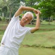 Asian senior male workout in the park — Stockfoto