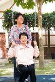 Asian senior enjoying swing in the park — Stock Photo