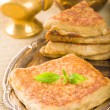 Mutabbaq a popular arab food where bread if stuffed with meat — Stock Photo
