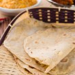 Постер, плакат: Indian flat bread called chapati in basket