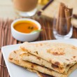 Постер, плакат: Indian flat bread called chapati on plate