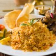Biryani mutton rice papadam with traditional background — Stock Photo #30146569