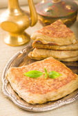 Mutabbaq a popular arab food where bread if stuffed with meat — Stock Photo