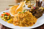 Biryani mutton rice papadam with traditional background — Foto Stock