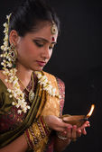 Traditional indian woman with oil lamp during the celebration of — Stock Photo
