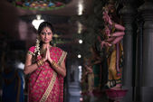 Traditional Young indian woman praying in the temple — Stock Photo