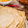 Chapatti roti and Indifood on dining table. — Stock Photo #30571223