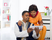Indian mother and son enjoying surfing with tablet in the living — Stock Photo