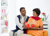 Indian son giving present to his mother — Stock Photo