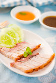 Chinese roasted pork served with soy and hoisin sauce — Stock Photo