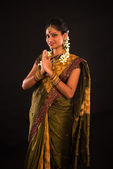 Traditional indian female greeting with dark background — Stock Photo