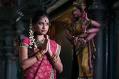 Traditional Young indian girl praying in the temple — Stock Photo