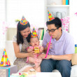 Asian family celebrating baby birthday party  — Stock Photo