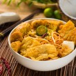 Chopstick and laksa curry noodles with plenty of raw ingredients — Stock Photo