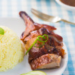 Stock Photo: Chinese roast duck rice drumstick