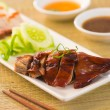 Stock Photo: Roasted duck, Chinese style , drumstick and chopstick