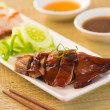 Roasted duck, Chinese style , drumstick and chopstick — Stock Photo